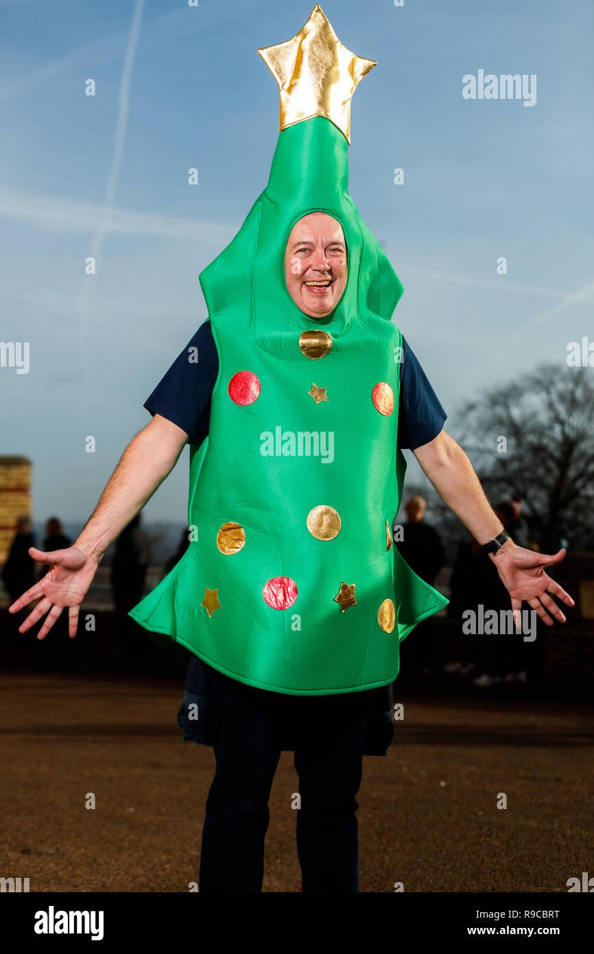 A Darts Fan Wearing A Christmas Tree Fancy Dress Costume Arrives