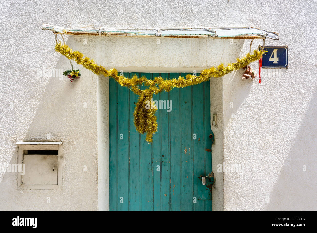 A Cheap, Used Golden Christmas Tinsel Decorating The Awning ...