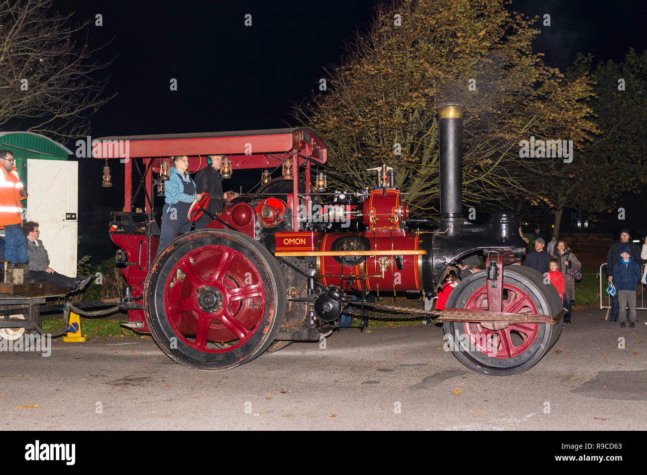 'Omon' (Reg No. FG1191), a 1926 steam powered Marshall Road Roller (steam engine, Works No. 80608) displayed as part of a night procession in the UK. - Stock Image