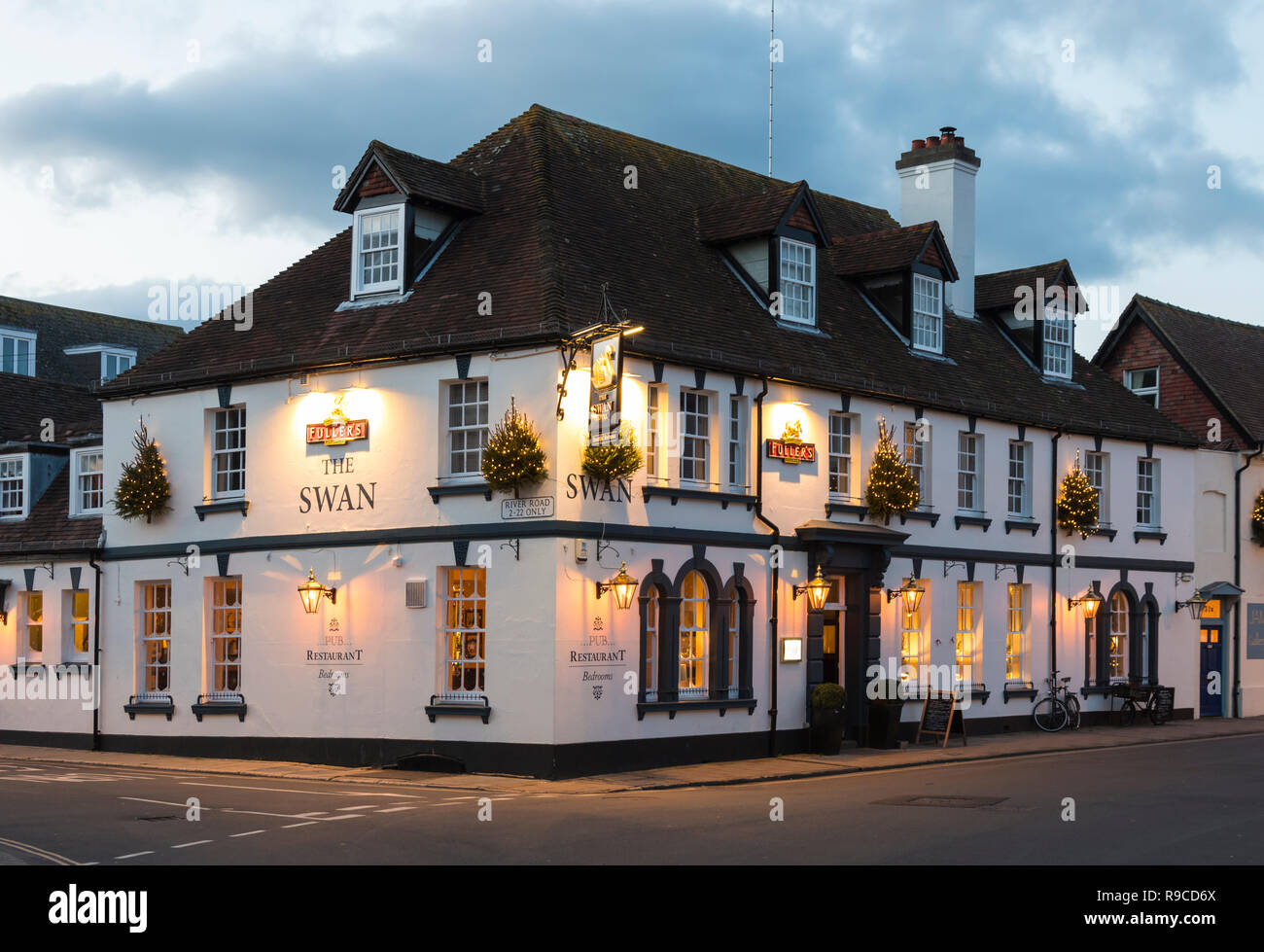 The Swan Hotel - A Pub and restaurant with bedrooms - Lit up late afternoon in Winter in Arundel, West Sussex, England, UK. - Stock Image