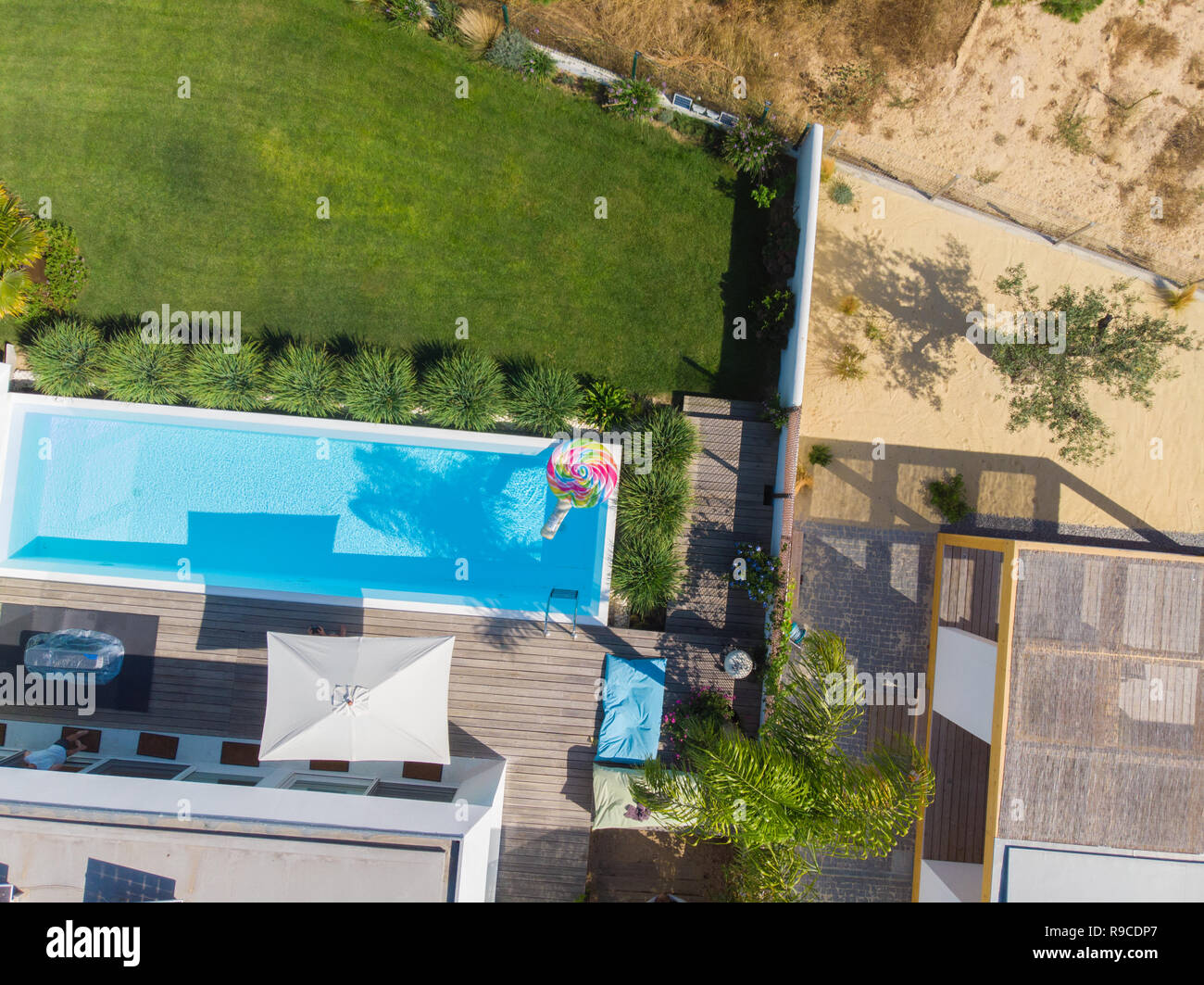 Garden With Swimming Pool top view of a garden with swimming pool in comporta stock