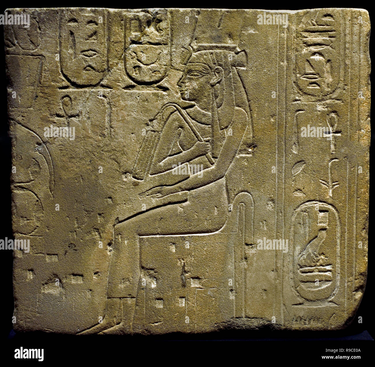 Nitokris ( Daughter of Wahibre Psamtik I, ) Relief Sandstone Dimensions: 49.5 x 45 cm  26th Dynasty Egypt, Egyptian. ( Wahibre Psamtik I, known by the Greeks as Psammeticus or Psammetichus ( 664–610 BC, was the first of three kings of that name of the Saite, or Twenty-sixth Dynasty of Egypt) , - Stock Image