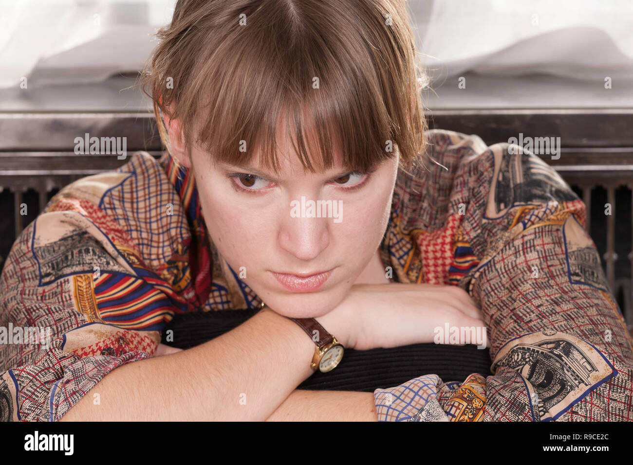 Young adult woman is pensive, USA - Stock Image