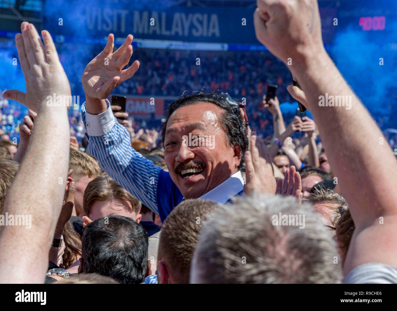 CARDIFF, UNITED KINGDOM. 06 May 2018. Cardiff City FC owner Vincent Tan participating in a pitch invasion after his side earned league promotion. - Stock Image