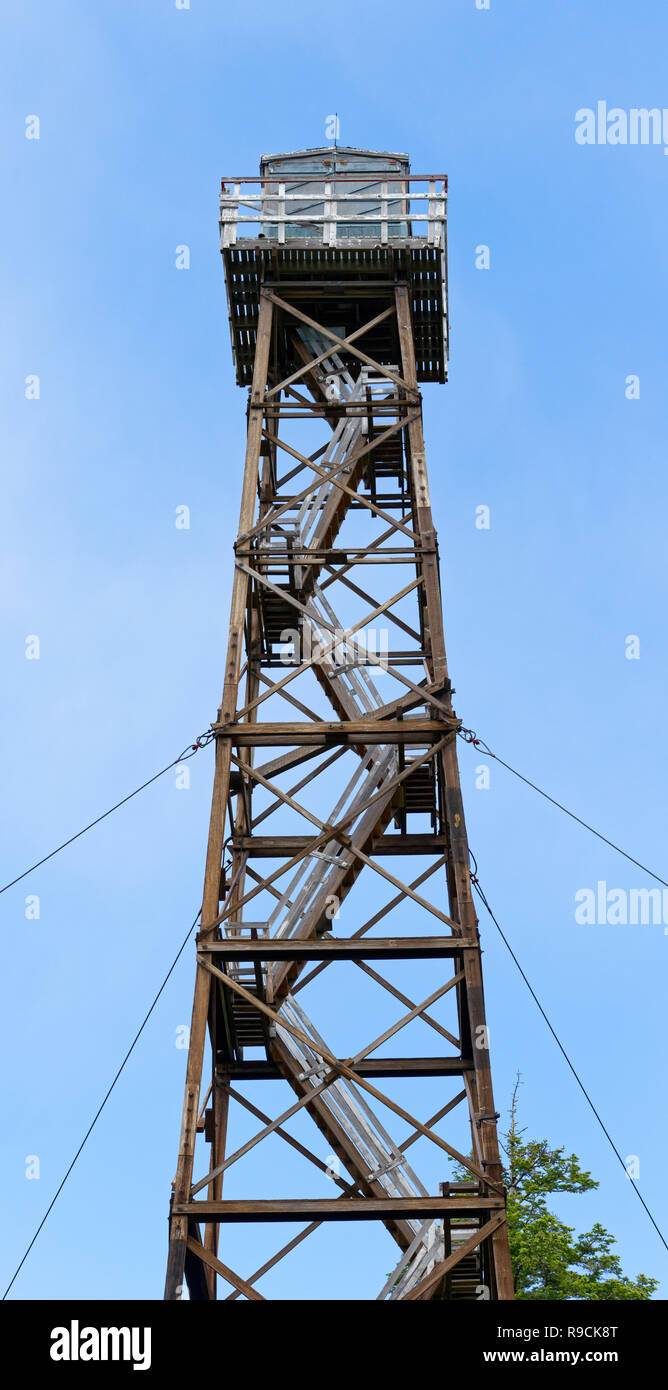 42,896.03787 closeup close up of Historic Frazier Lookout Tower forest fire tower, Malheur National Forest, blue sky background, Oregon USA - Stock Image