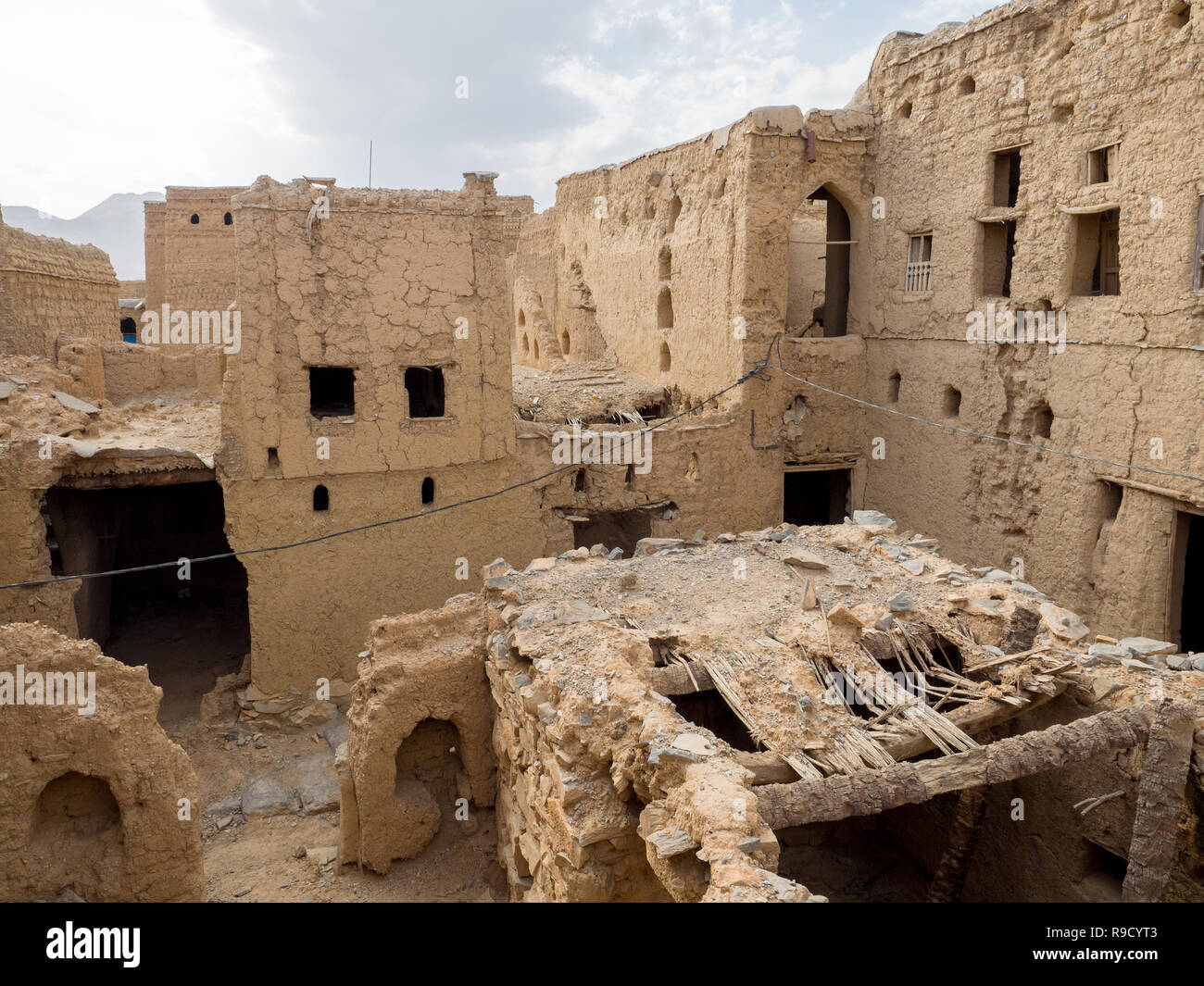 Panoramic view of several ancient mud brick houses ruins in Al Hamra, Oman - Stock Image