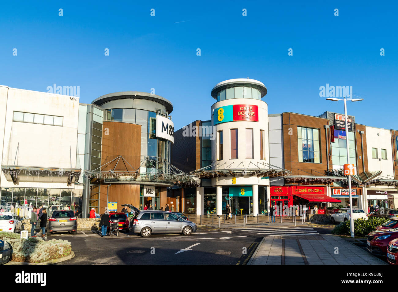 Westwood Cross shopping centre, England. Car park with M&S store entrance, Cafe Rouge and DW sports and fitness club entrance. Super Saturday. - Stock Image