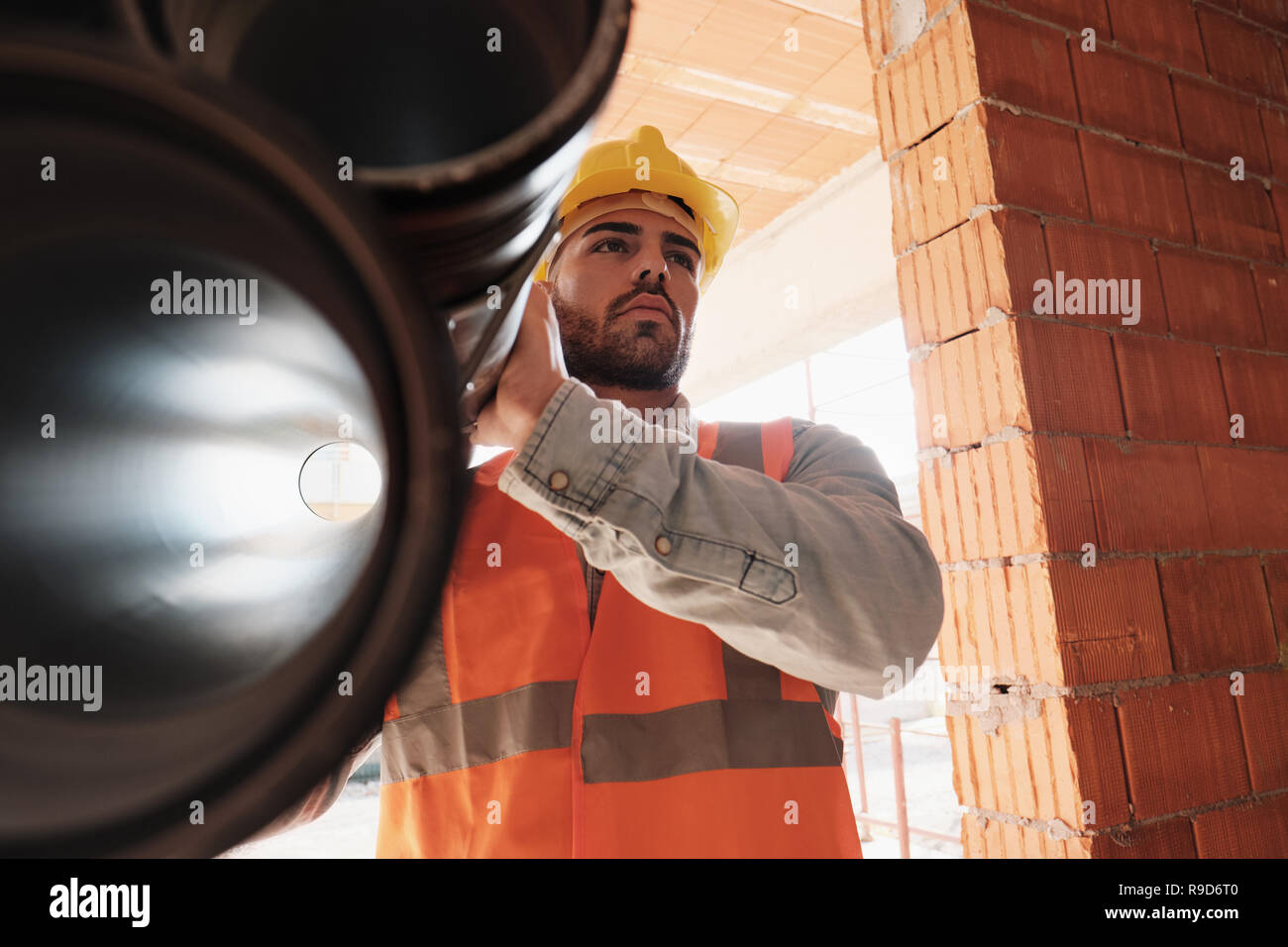 Portrait Of Young Man Working In Construction Site Stock Photo