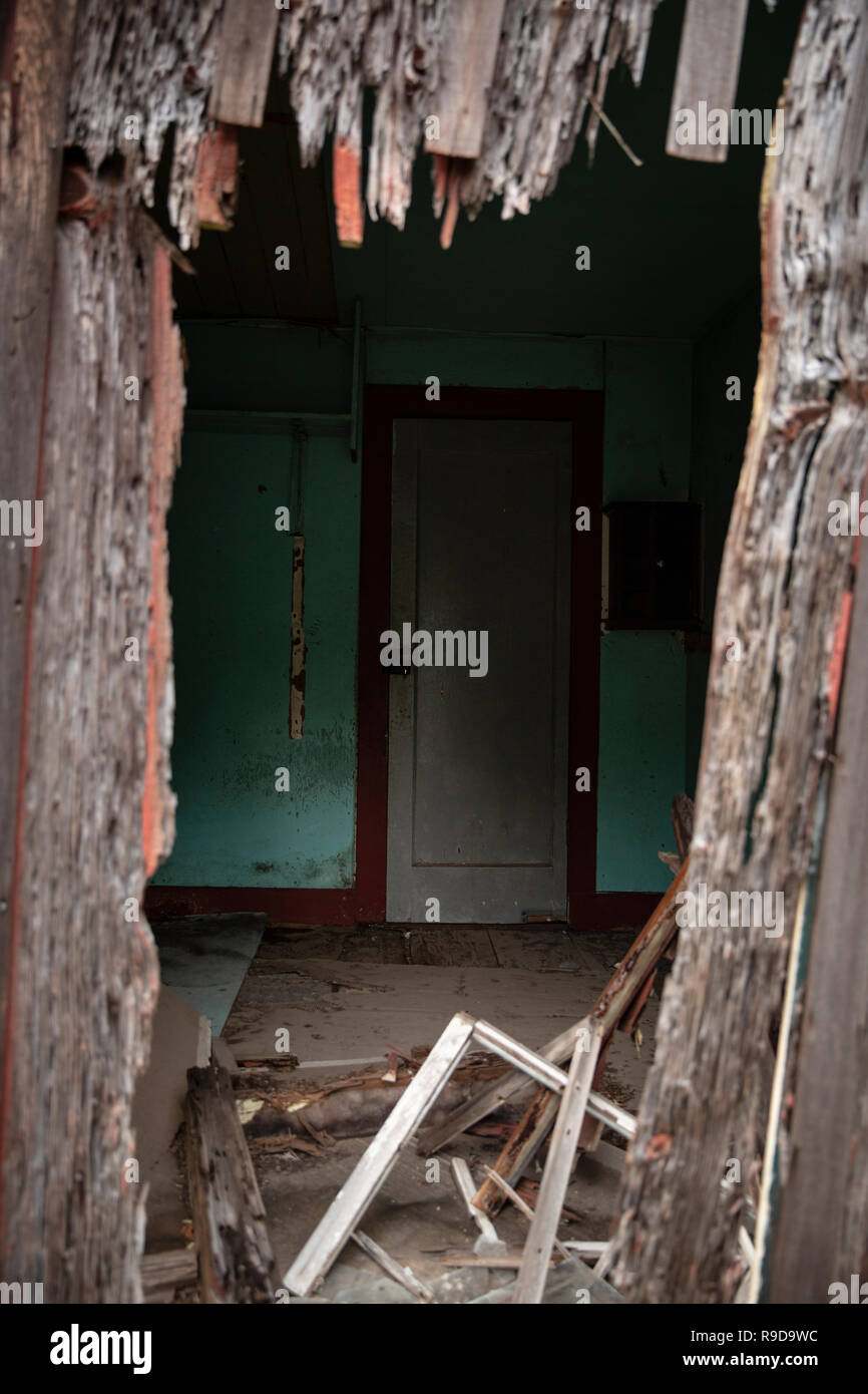 Peeping into an abandoned house in Hawaii Stock Photo