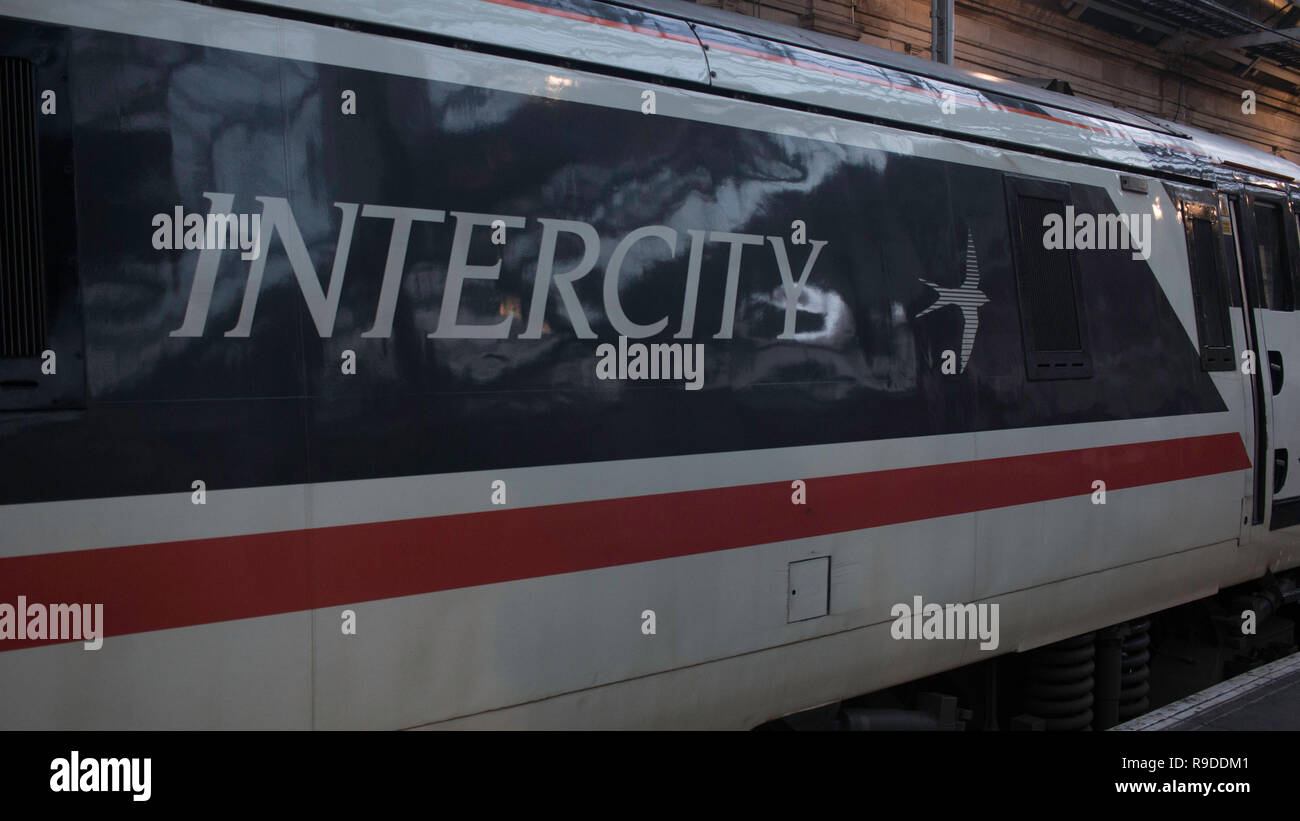'Intercity' logo on an Intercity-liveried British Rail class 91 electric locomotive, no. 91119, taken at Edinburgh Waverley railway station. - Stock Image