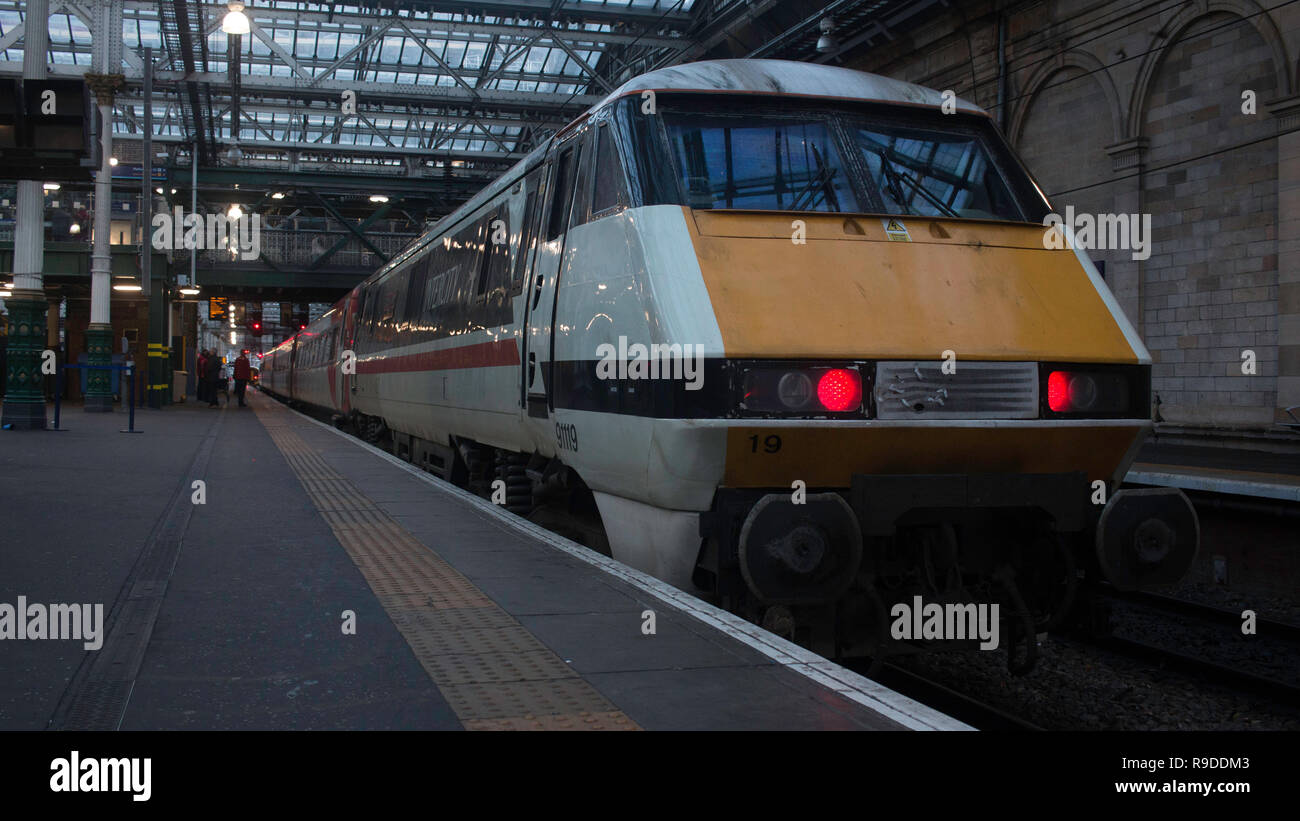 A frontal shot of an Intercity-liveried British Rail class 91 electric locomotive no. 91119, taken at Edinburgh Waverley station. - Stock Image