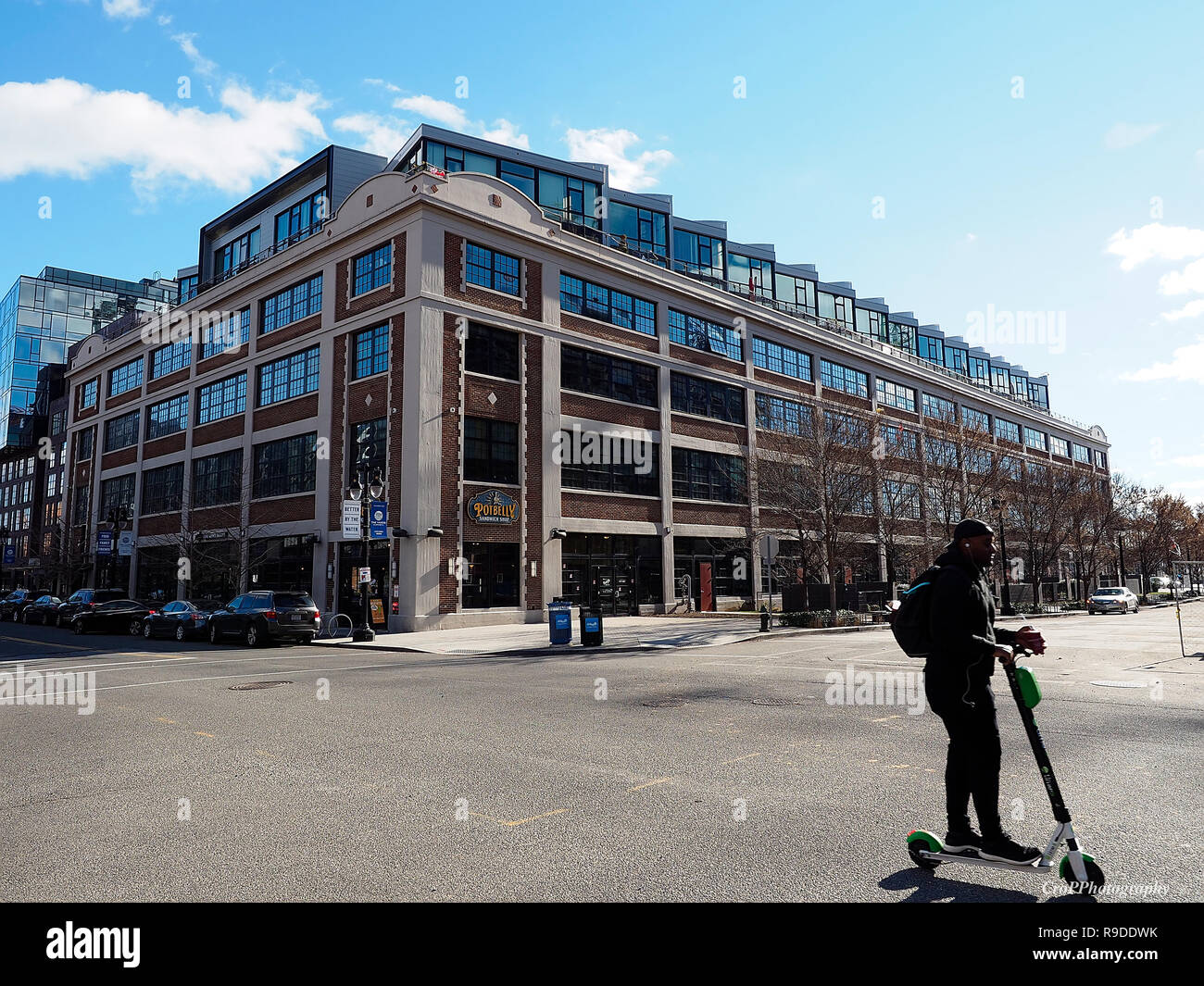 Adult male riding rent scooter in Capitol Riverfront area in Washington DC Stock Photo
