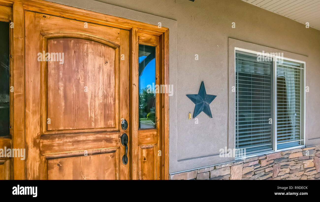 Rustic wooden front door with glass panes of home - Stock Image