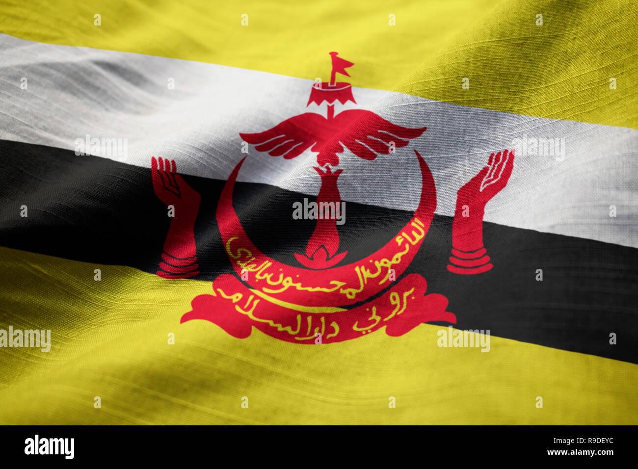 Closeup of Ruffled Brunei Flag, Brunei Flag Blowing in Wind - Stock Image