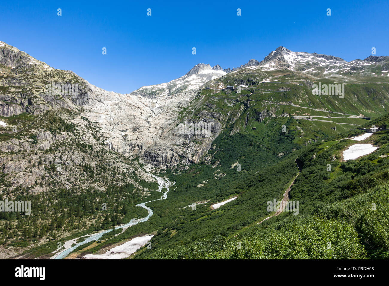 Alpine landscape with the source of Rhone river on the left and the road to Furka Pass on the right, Valais, Switzerland Stock Photo