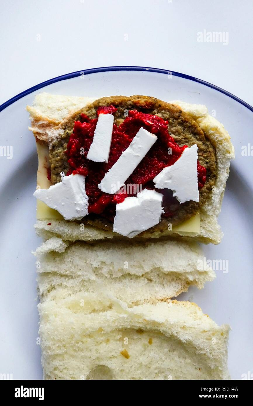 Beef Burger prepartion with Bread Bun and Feta Chese - Stock Image