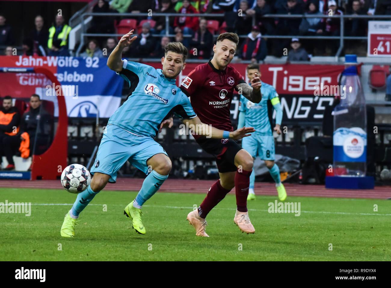 Germany, NŸrnberg, Max Morlock Stadion - 22 Dec 2018 - Soccer, 1.Bundesliga - 1.FC NŸrnberg vs. SC Freiburg -  Image: (Florian Niederlechner (SC Freiburg, #7), Georg Margreitter (1. FC NŸrnberg, #33).  Foto: HMB Media / Ryan Evans Credit: Ryan Evans/Alamy Live News - Stock Image