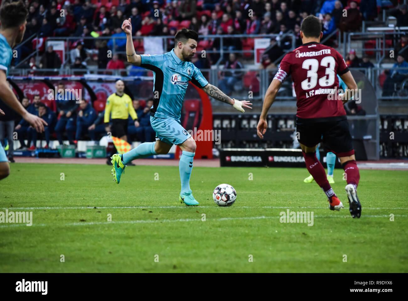 Germany, NŸrnberg, Max Morlock Stadion - 22 Dec 2018 - Soccer, 1.Bundesliga - 1.FC NŸrnberg vs. SC Freiburg -  Image: (From L-R)  Manuel Gulde (SC Freiburg, #5), Georg Margreitter (1. FC NŸrnberg, #33)  Foto: HMB Media / Ryan Evans Credit: Ryan Evans/Alamy Live News - Stock Image