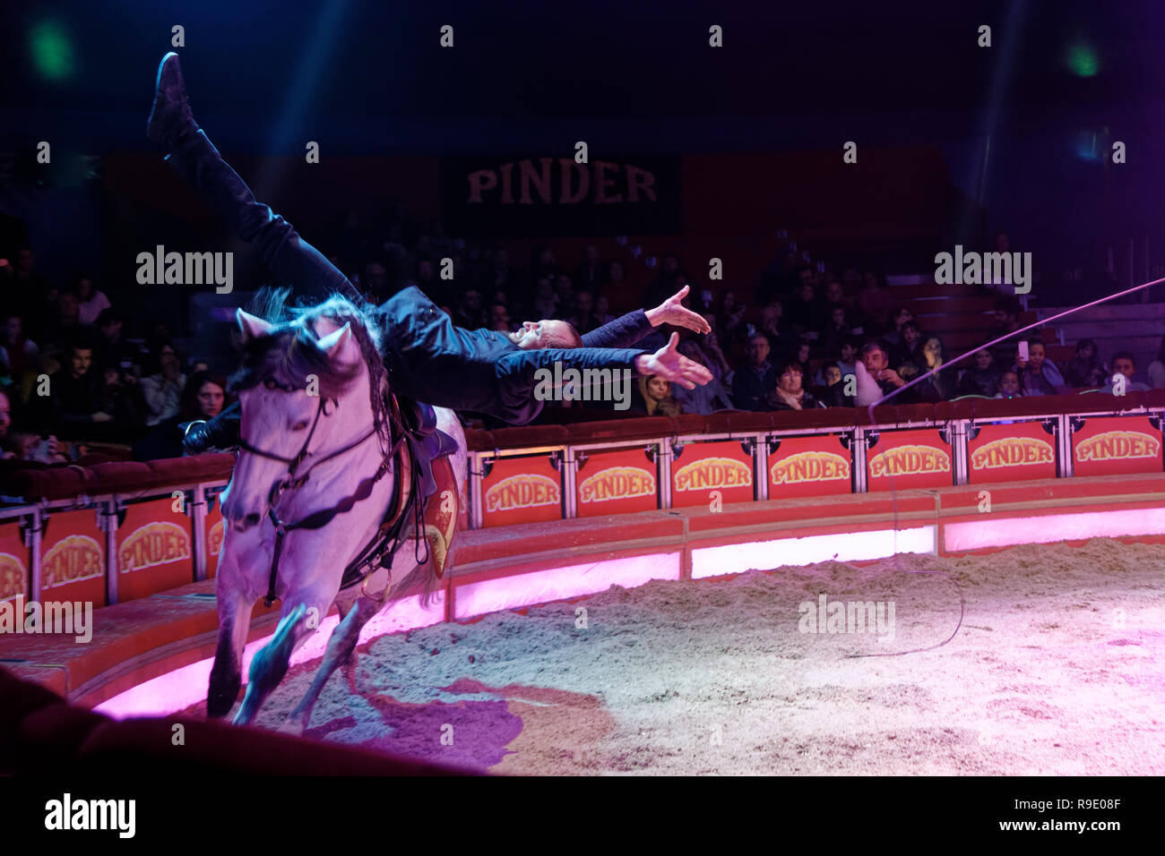 Paris, France. 22nd Dec, 2018. Equestrian acrobatics, Horses Back Men perform during the show of new stars of Cirque Pinder at the Pelouse de reuilly on December 22, 2018 in Paris, France. The show of emotions, dreams and shivers, lasts until February 3, 2019. Credit: Bernard Menigault/Alamy Live News - Stock Image