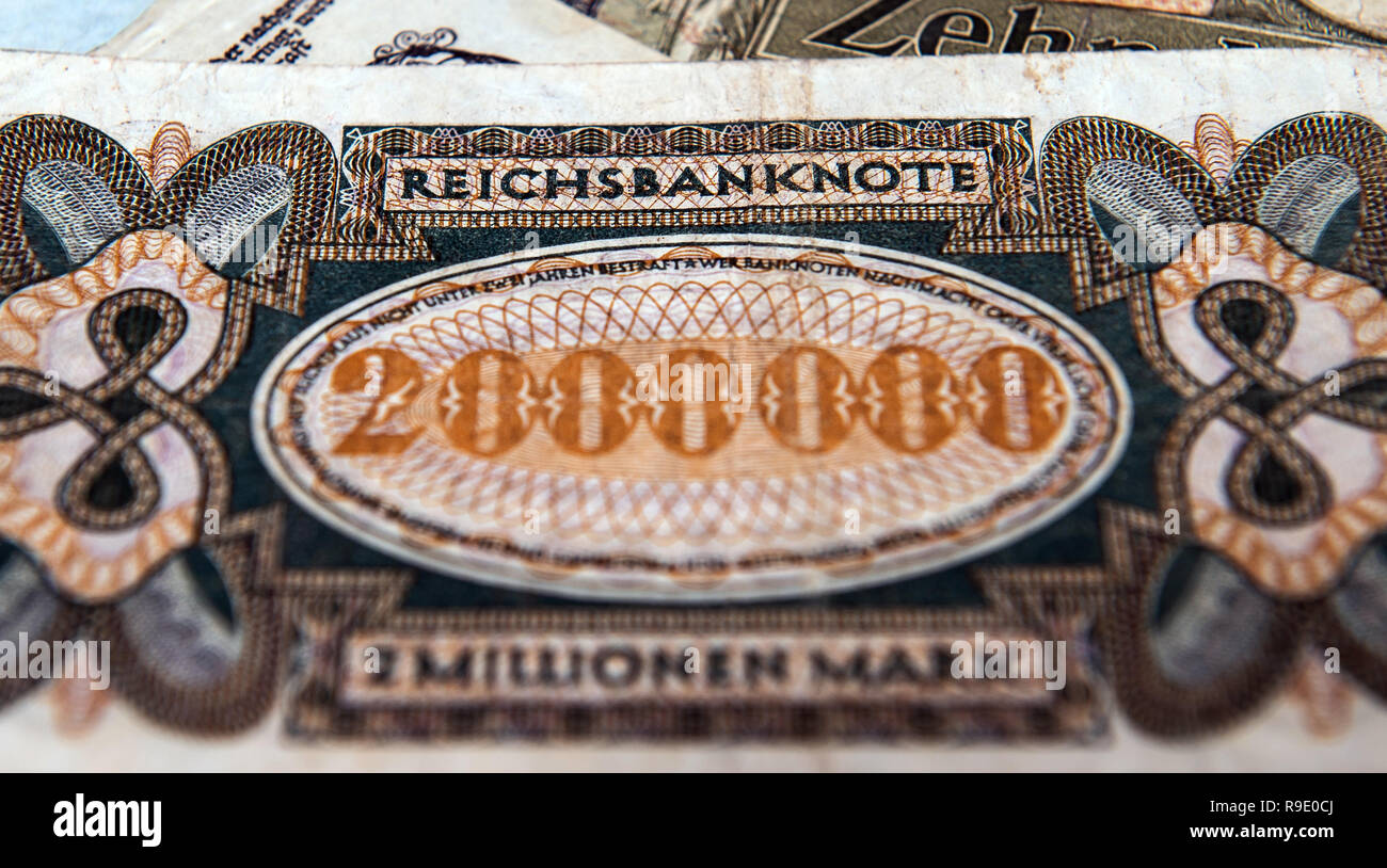 Rottweil, Germany. 23rd Dec, 2018. ILLUSTRATION - A Reichsmark banknote to the value of two million marks of the Reichsbank lies in a residential building on a stack of Reichsmarks. From 1924 to 1948, the Reichsmark was the official currency in the German Reich. Credit: Silas Stein/dpa/Alamy Live News - Stock Image