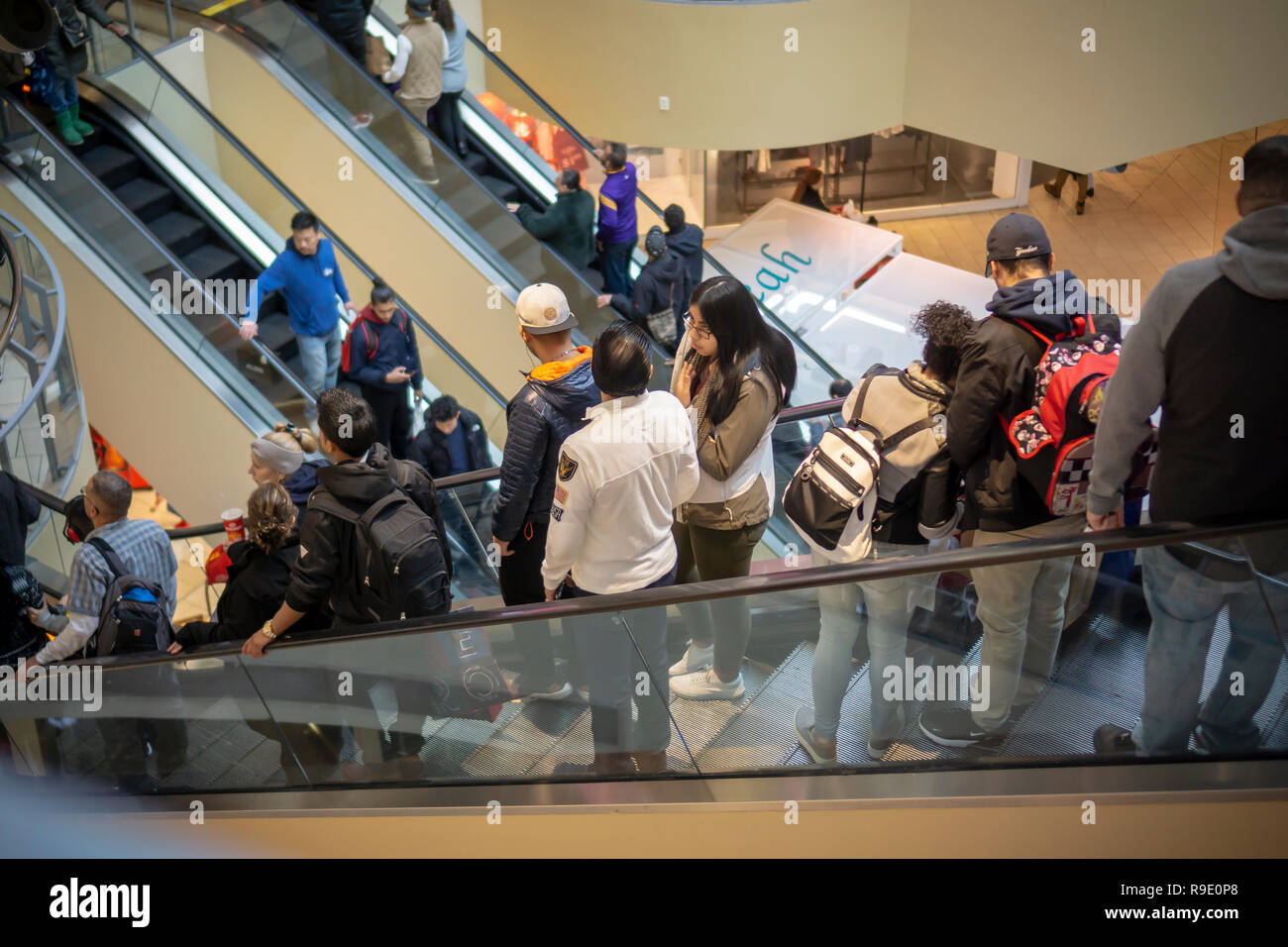 90b35e914a 2018 Crowds of last minute shoppers pack the Queens Center Mall in the  borough of Queens in New York on the so-called Super Saturday. the Saturday  ...