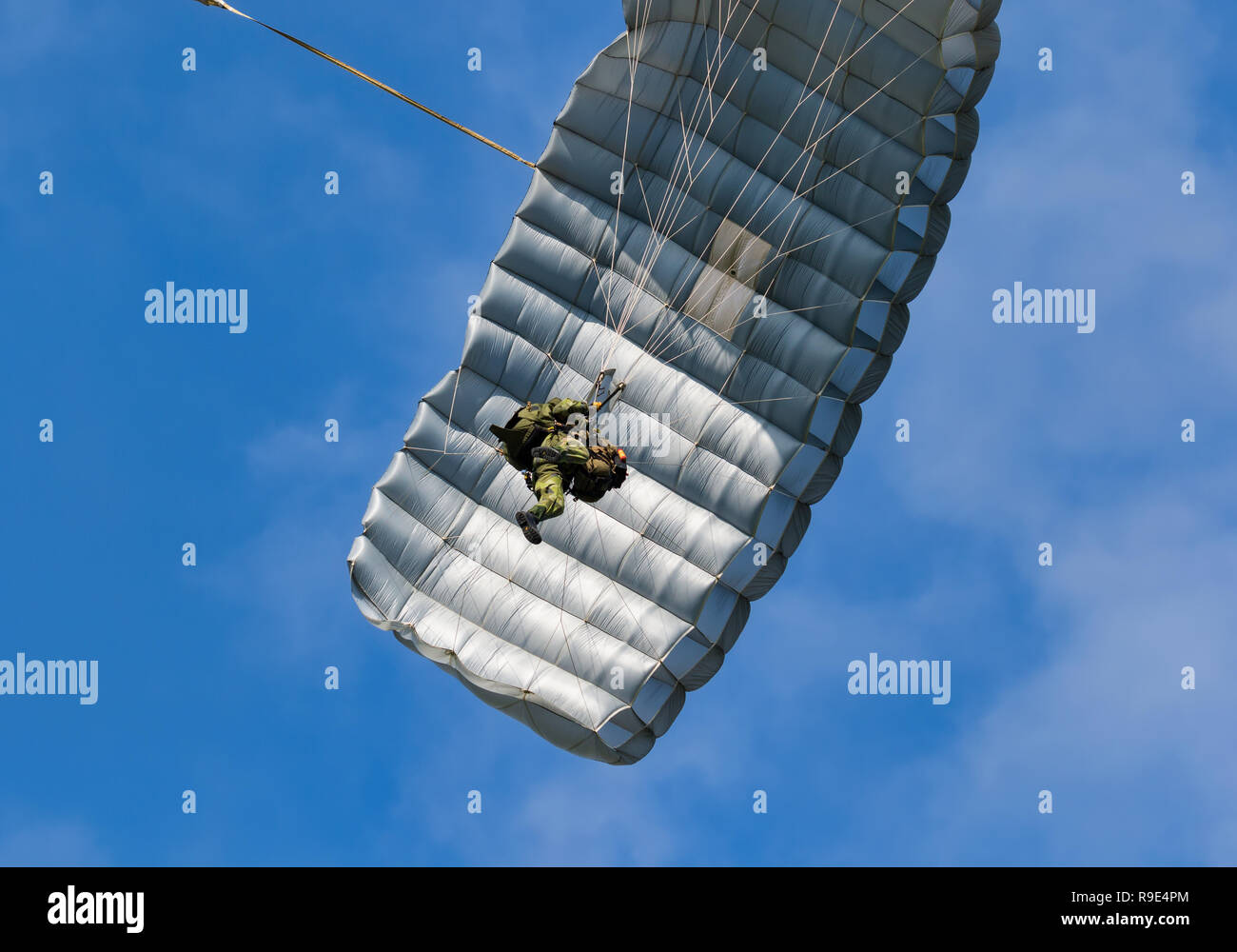 paratrooper against blue sky - Stock Image