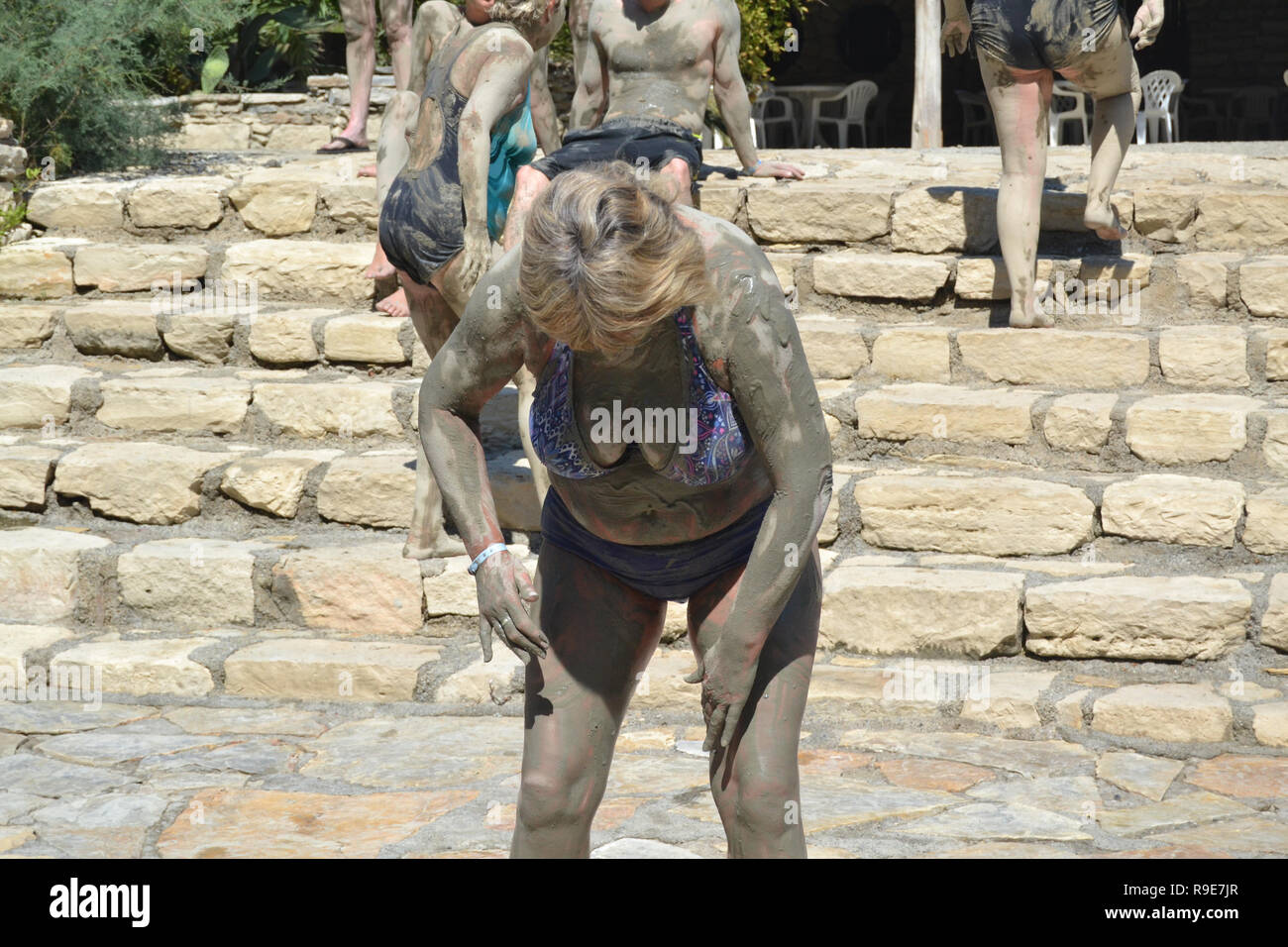 Woman tourist smeared in mud at Turkish mud bath - Stock Image