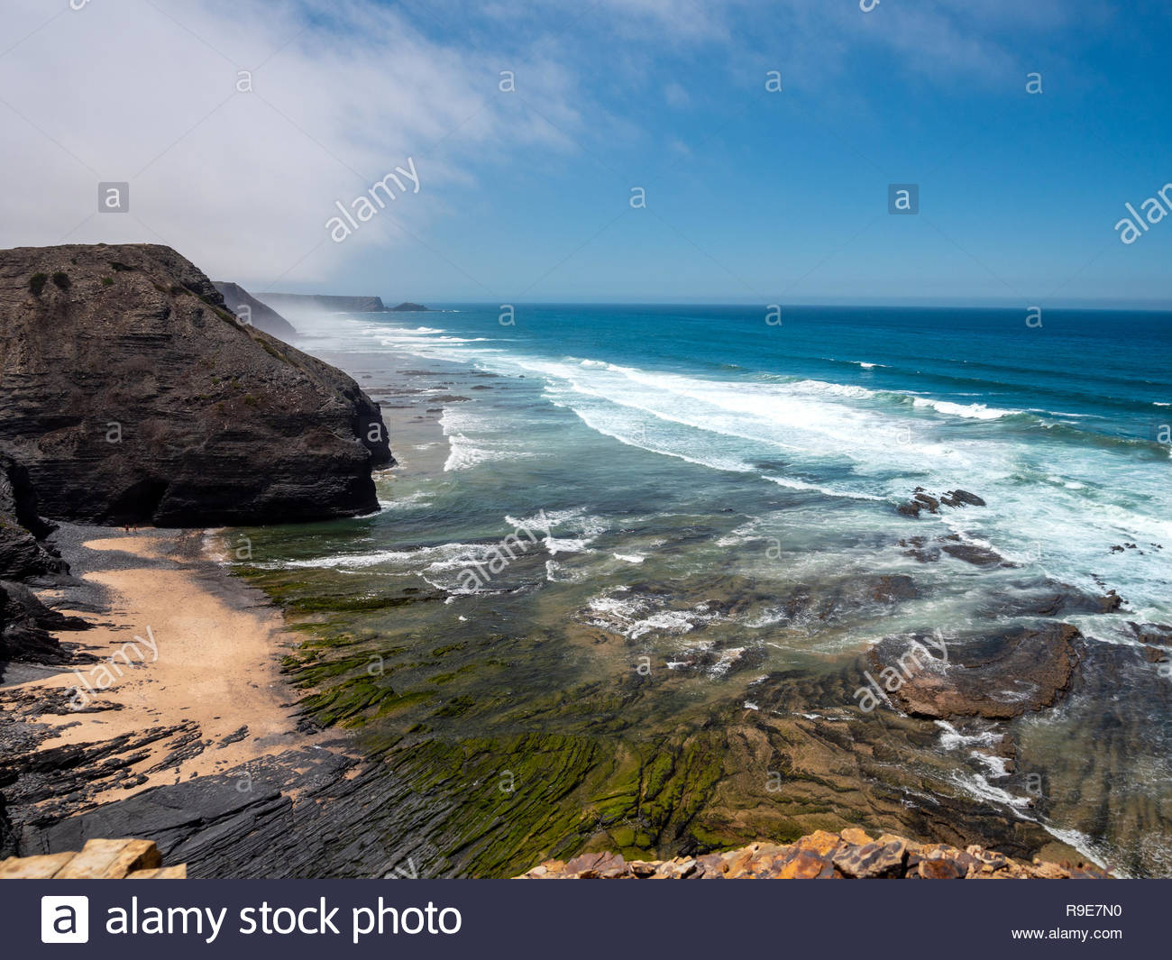 View on cliff at the atlantic ocean in Portugal Europe with. The coastline is used by portuguese and tourists to chill or for big wave surfing - Stock Image