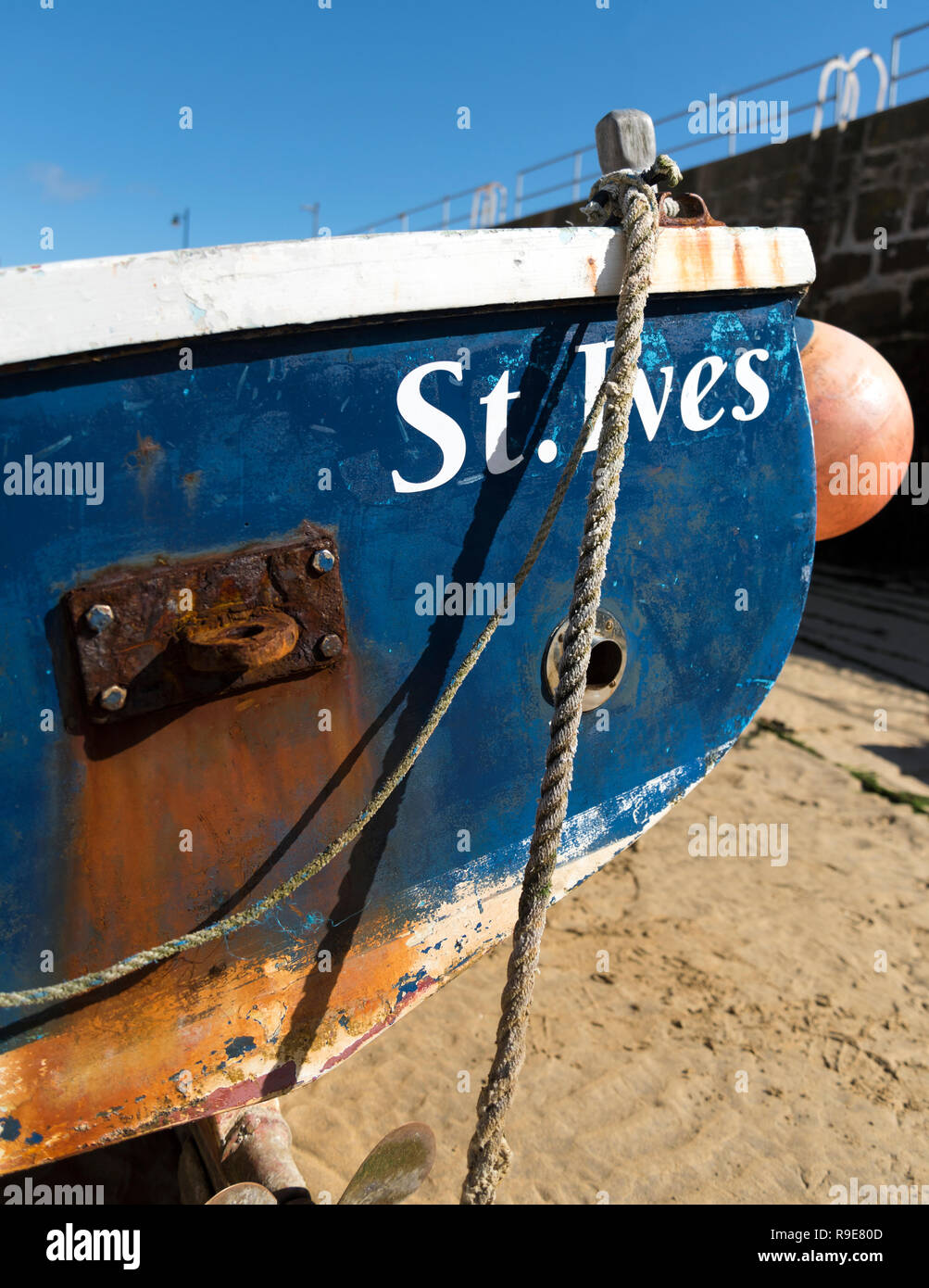 St.ives fishing boat in St.ives harbour on moorings in blue sky - Stock Image