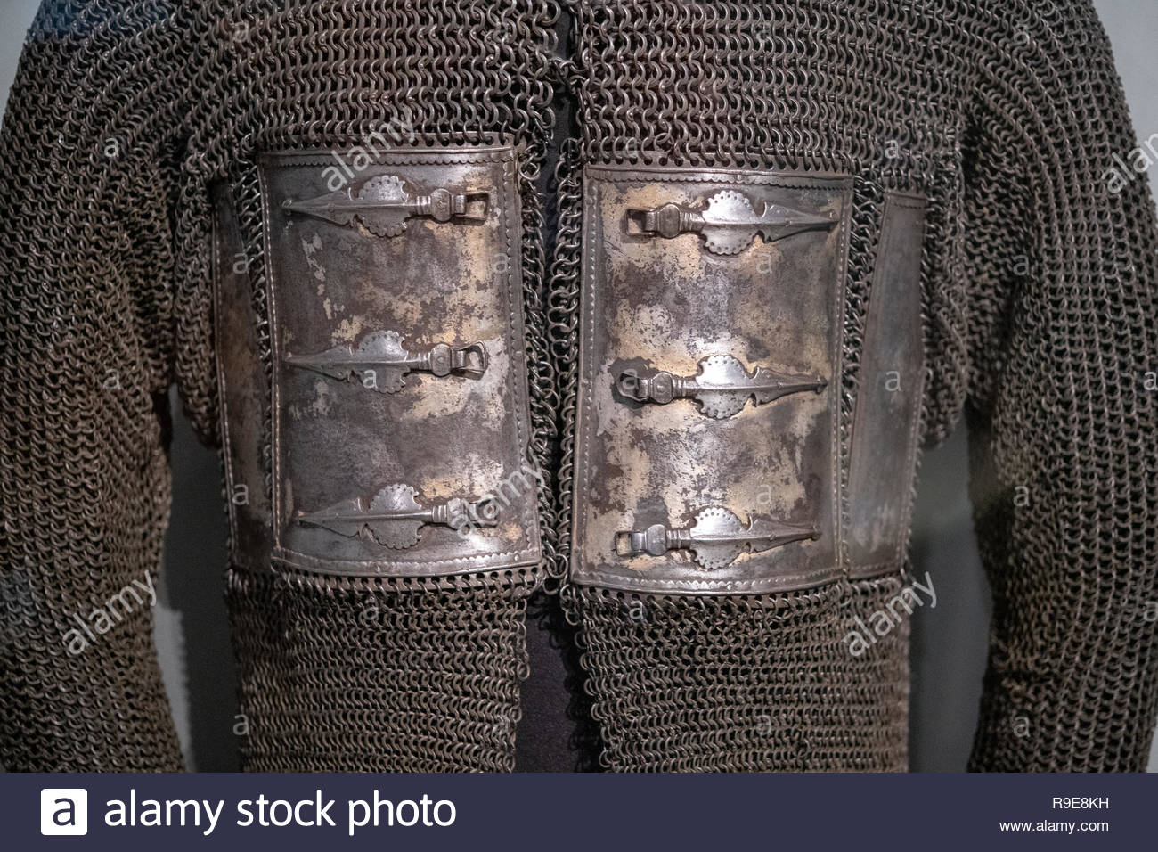 An antique  hybrid armour. Made of metallic plates and mail, the military object offered protection and flexibility to soldiers and warriors of the pa - Stock Image