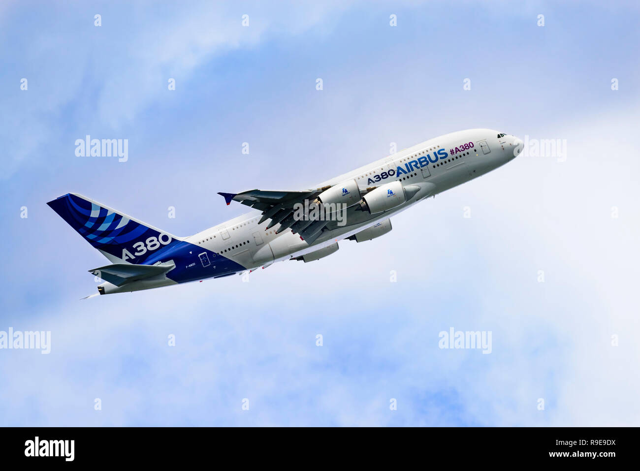 Airbus A380 airliner climbs away after take-off, giving a side view and showing the windows of the two passenger decks. Stock Photo