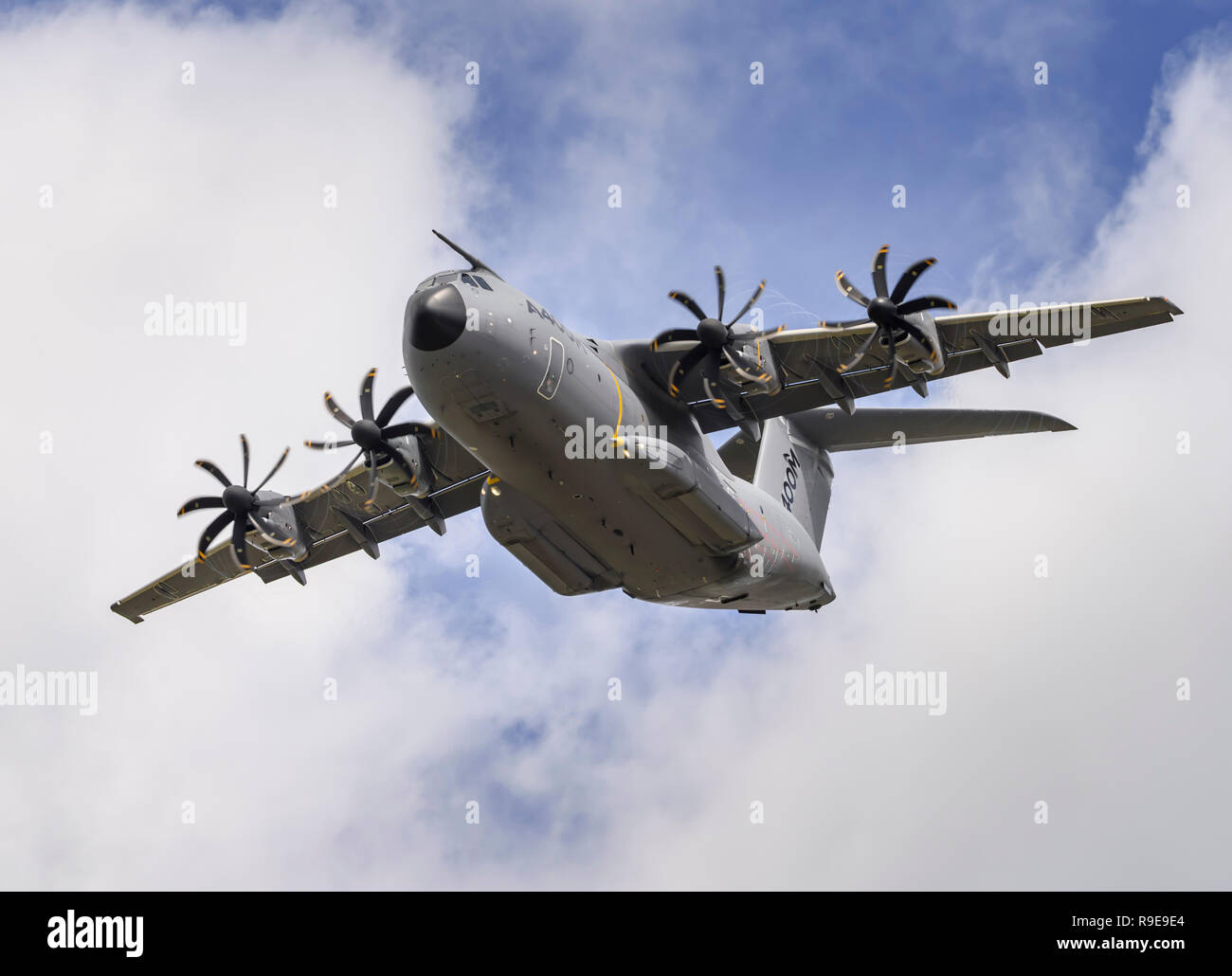 Airbus A400M Atlas military transport aircraft performs a clean pass (wheels up), flying overhead from right to left. - Stock Image