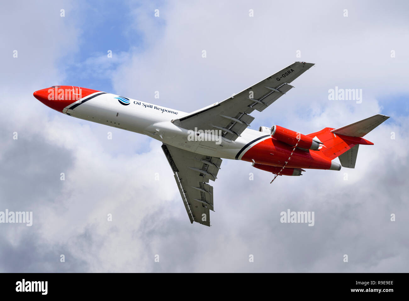 Boeing 727-2S2F (RE) Oil Spill Response aircraft reveals the high-lift devices in its wings as well as the spray boom mounted beneath the engines. - Stock Image