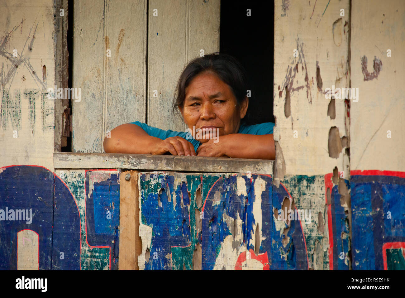 An Old Woman Looking Out Of Her Hut In Belen Market At Iquitos Peru