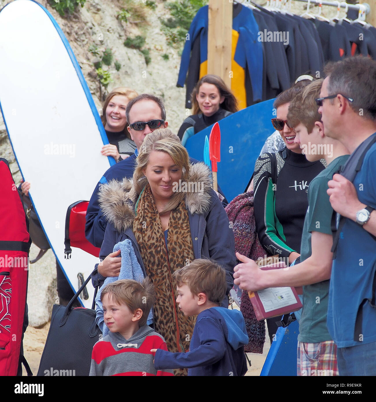 Watergate Bay Summer Beach crowds and vibe sunshine and surfing - Stock Image