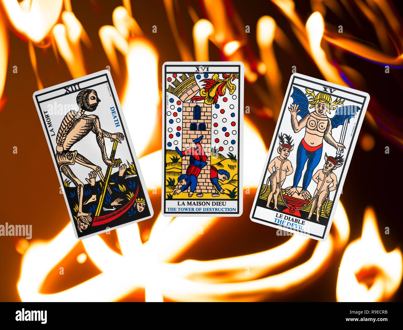 Tower, Devil and Death from a tarot deck of the Tarot de Marseille, floating on a burning fire background - Stock Image