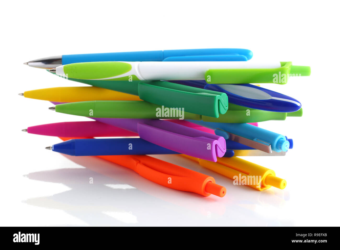 Multi colored ball pens on white background Stock Photo