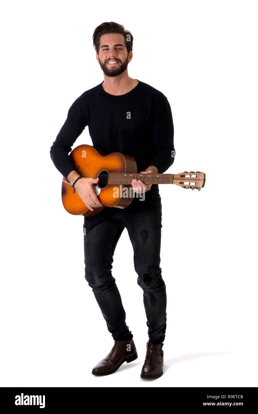 Full Length Portrait of Young Man Playing Guitar in Studio Stock Photo