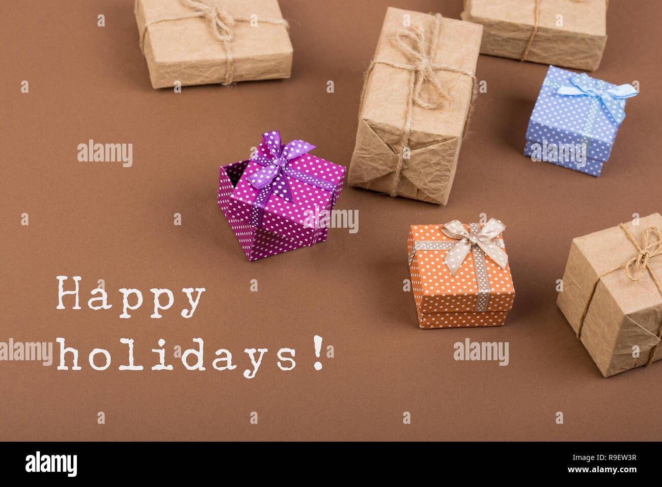 Handmade Gift Boxes On Brown Paper Background And Text Happy