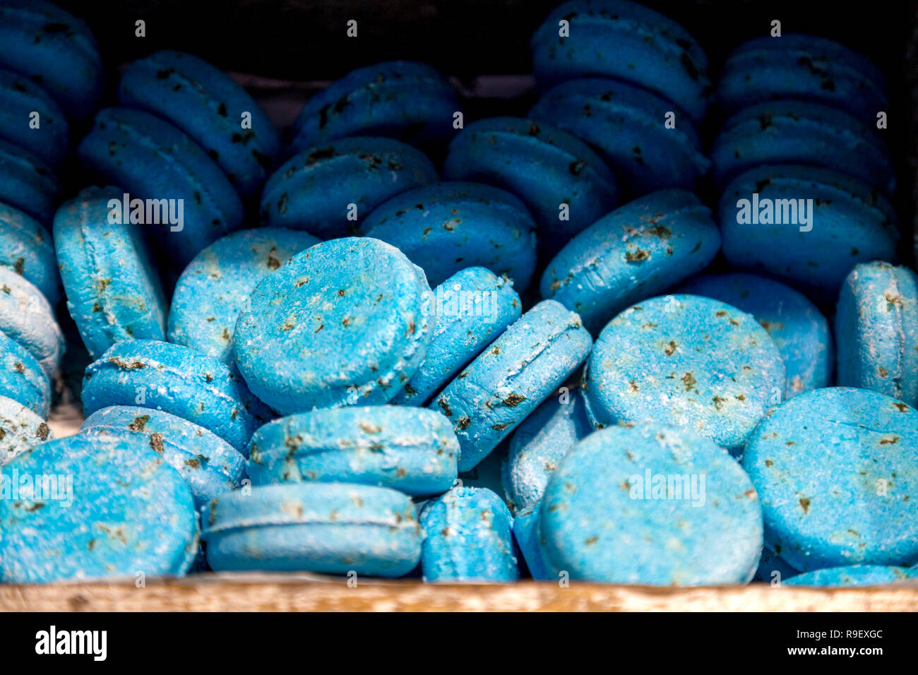 Blue solid shampoo bars at the Lush handmade cosmetics store in Oxford Street, London, UK - Stock Image