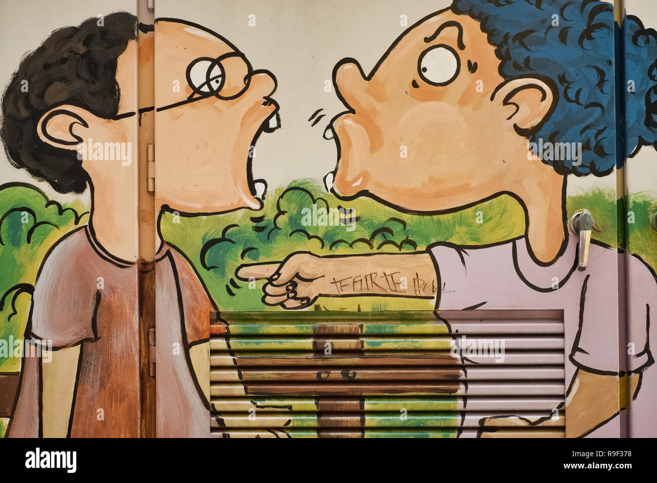 A painting applied by a student to beautify an ungainly power distributor in Bangkok, Thailand, depicting an argument or quarrel between youngsters - Stock Image
