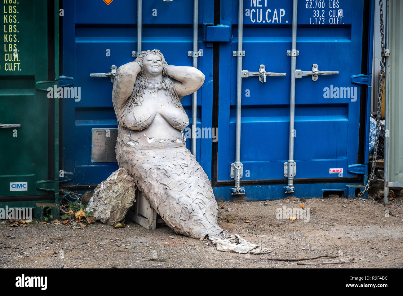 Mermaid has seen better days - Stock Image