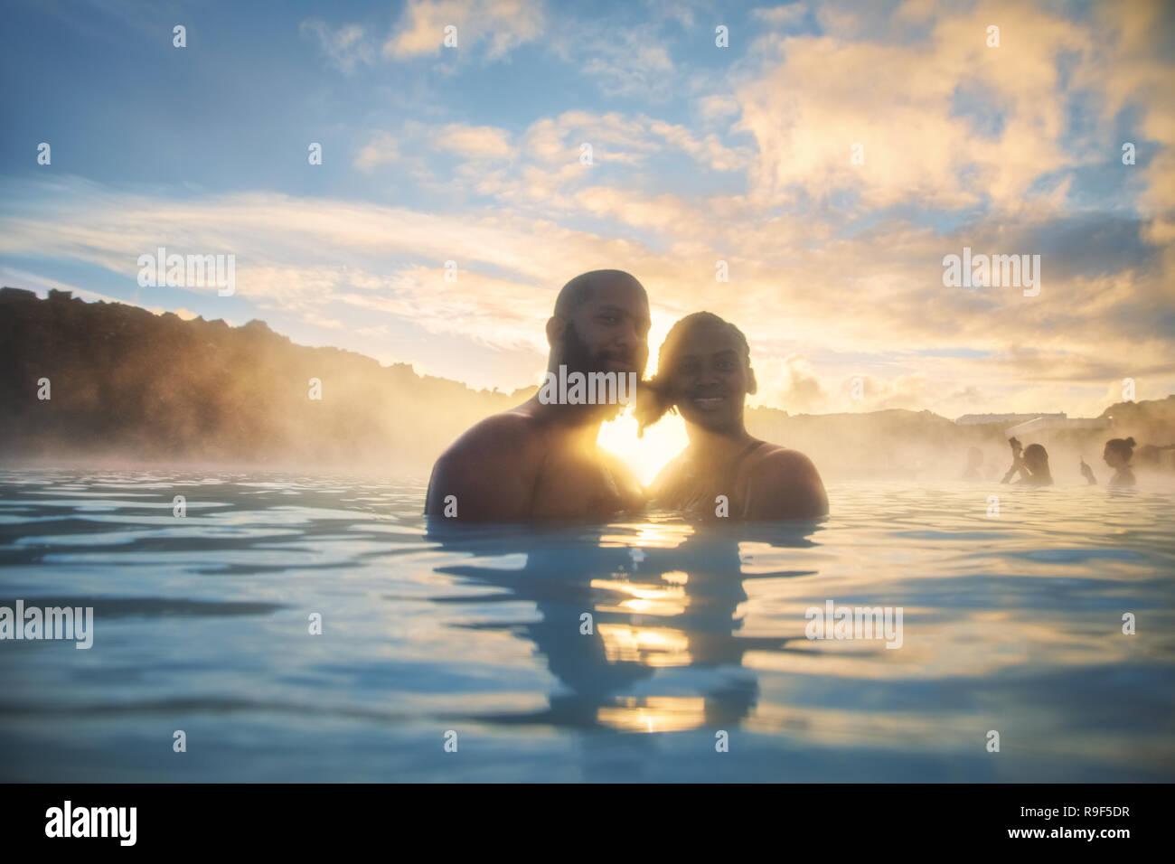 Couple love heart enjoy thermal springs hot warm bath pool Iceland Blue Lagoon - Stock Image