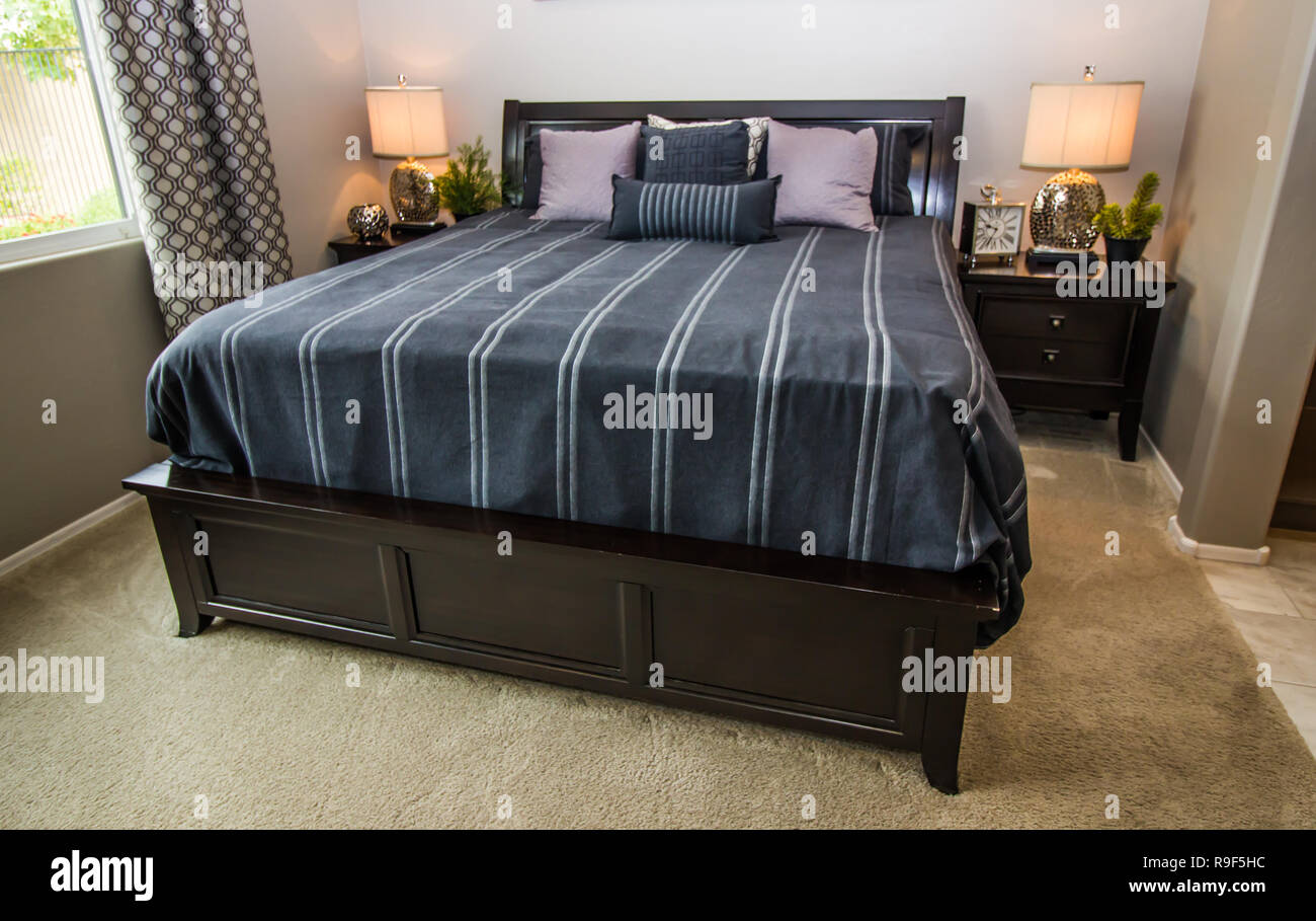 Master Bedroom With Large Bed Lamps And Nightstands Stock Photo Alamy