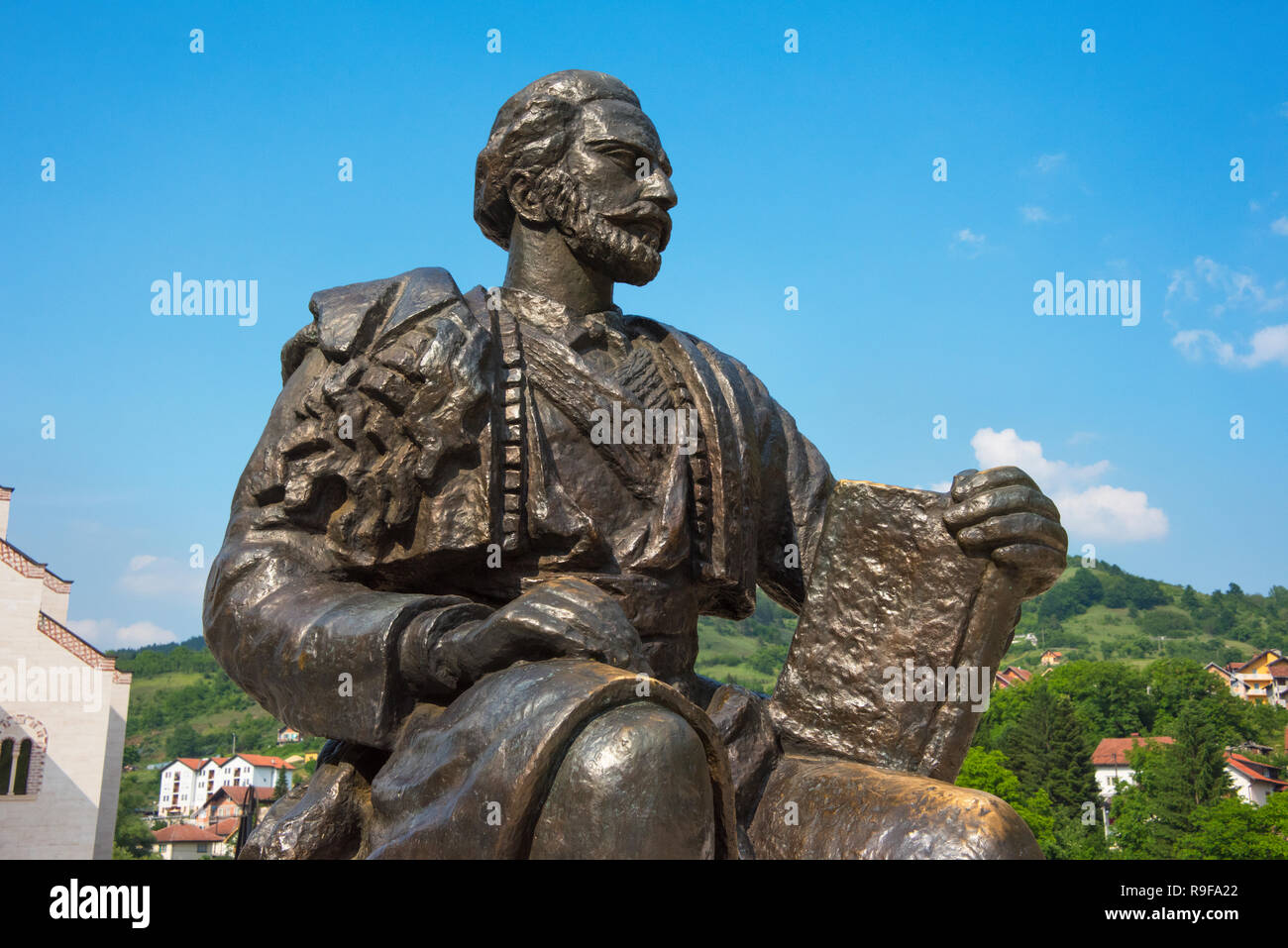 Statue of Ivo Andric, Andricgrad (also known as Andric's town or Stone town) dedicated to the famous writer, Ivo Andric, Visegrad, Bosnia and Herzegov - Stock Image