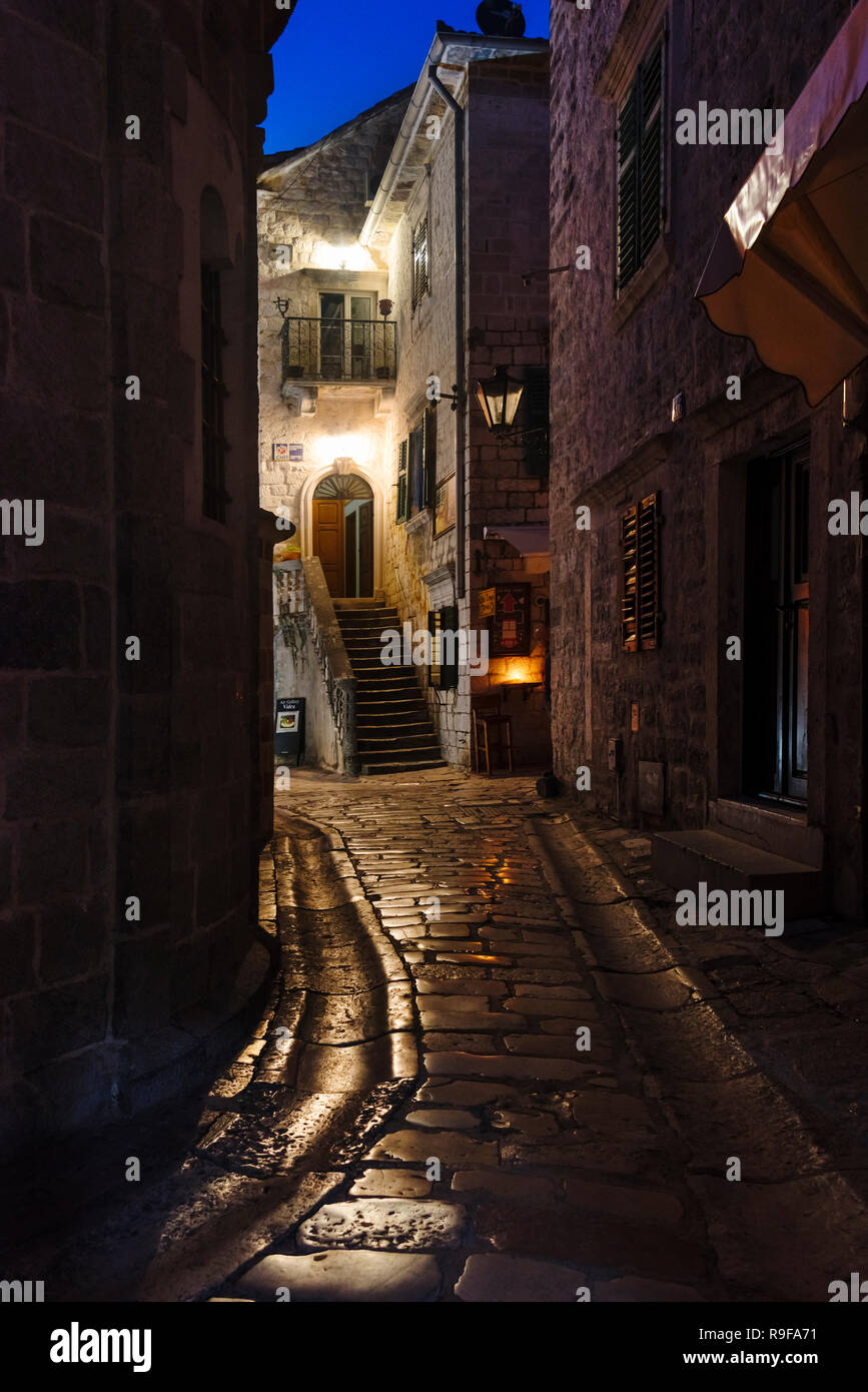Night view of the old town with cobblestone street, Kotor, Montenegro - Stock Image
