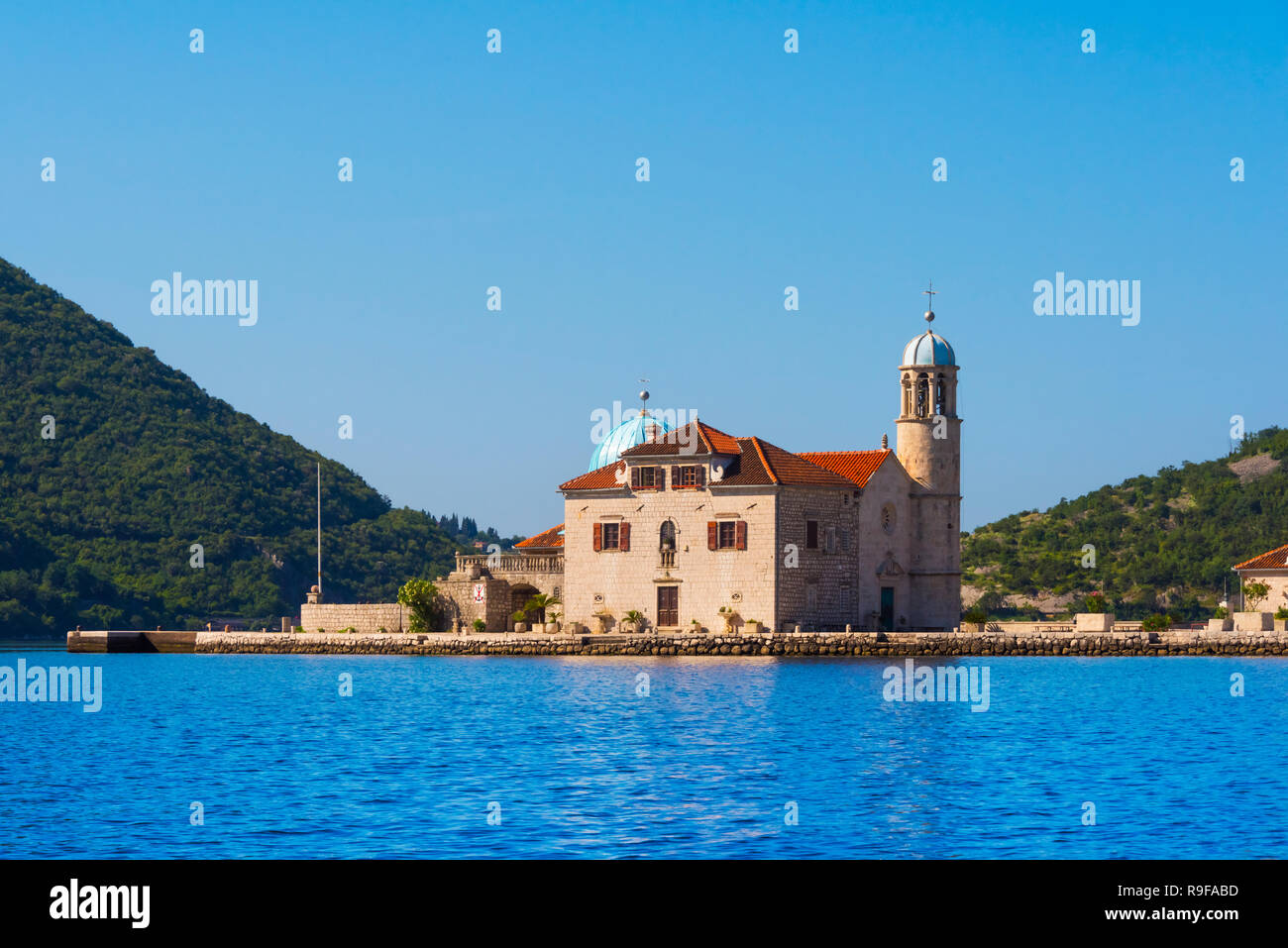Our Lady of the Rocks, an artificial island, with the Roman Catholic Church of Our Lady of the Rocks, Perast, Montenegro Stock Photo