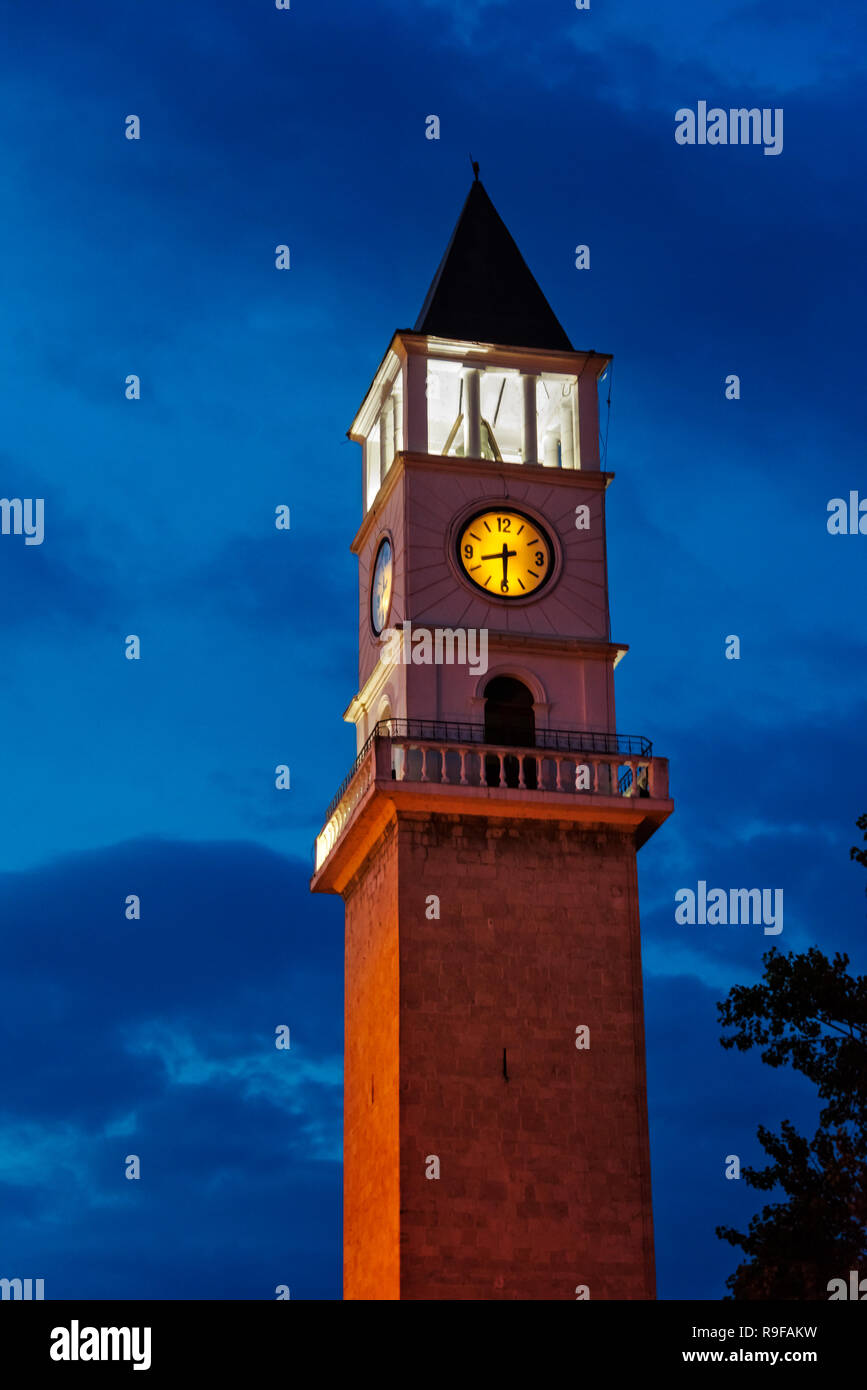 Night view of clock tower in Skanderbeg Square, Tirana, Albania - Stock Image