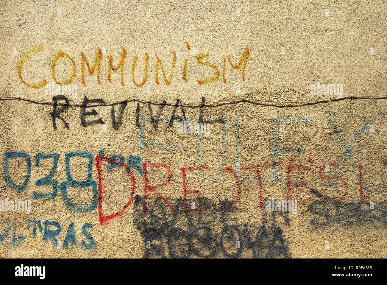 Old wall with scripts, Communism Revival, Prizren, Kosovo - Stock Image