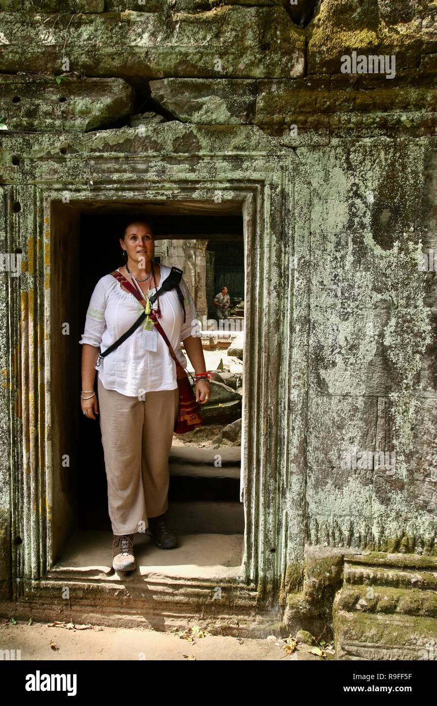 A solo woman traveller exploring ruins in the jungles of Cambodia Stock Photo